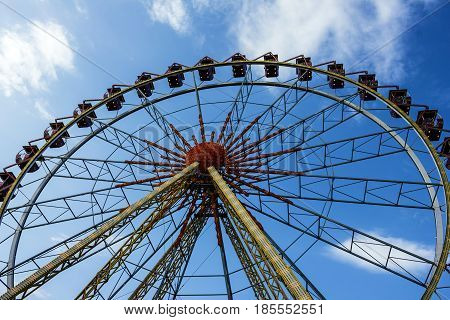 Ferris wheel in the amusement park in evening, Odessa, Ukraine.