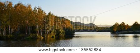 Between the hillock and the rock there is not a large lake, in the middle of the lake there are several islands on which birches and mosnas grow, many travelers call the lake a pearl of the harsh edge