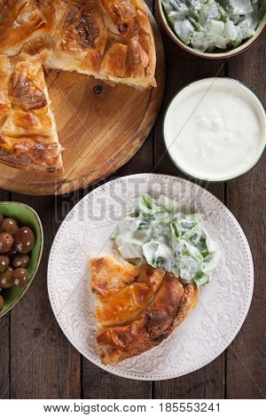 Phyllo pastry cheese pie with yogurt and salad