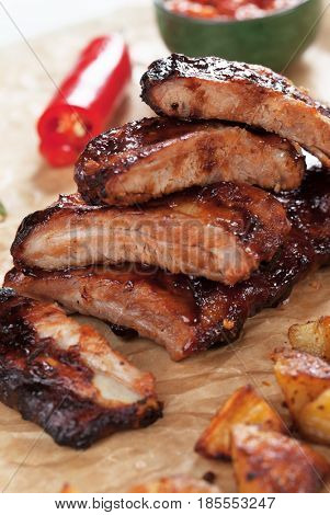 Oven roasted pork ribs marinated in barbecue sauce and glazed with honey