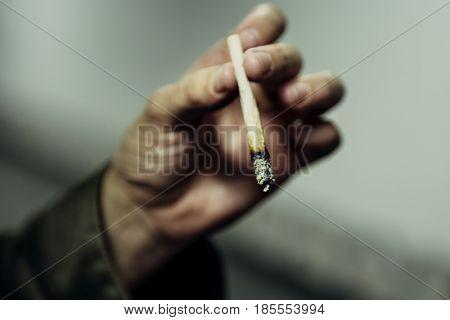 Homeless Man Hand Holding Cigarette