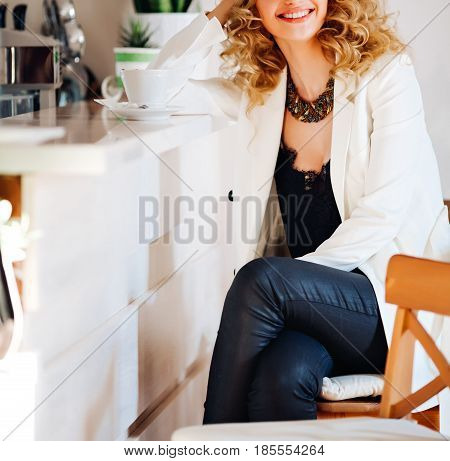 Close-up trendy autumn outfit of young sensual woman e.modern young lady. stylish jacket, coffee break, urban street style