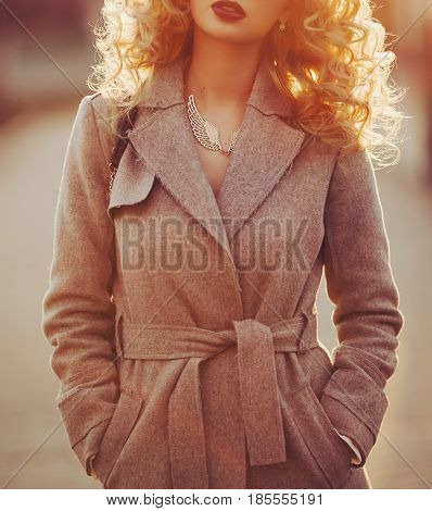 Beautiful young modern woman smiling happy and cheerful in trench coat.