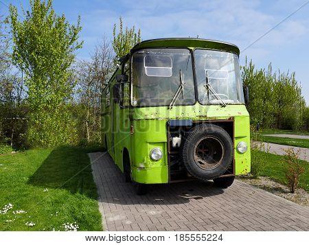 Ouddorp The Netherlands - April 9 2017: Vintage style old scrap green retro vintage camper on camper drive-in De Klepperstee
