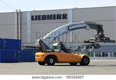 Rostock, Germany - May 9, 2017: Container loader - reach stacker in the test area of Liebherr crane building factory, Rostock, Germany.