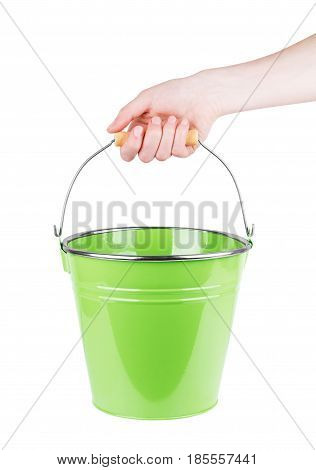 Human hand holding empty plastic pail isolated on white