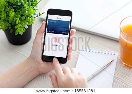 Women hand holding phone with debit card app touch pay on screen