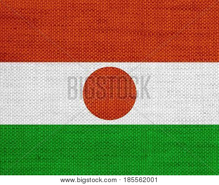 Colorful and crisp image of flag of Niger on old linen