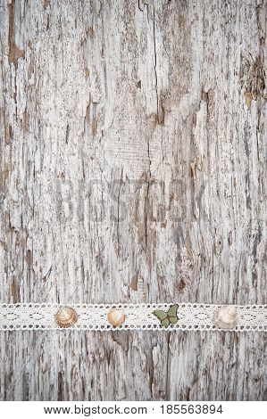 Shabby Chic Background With Seashells And Lace Fabric On Old Wood