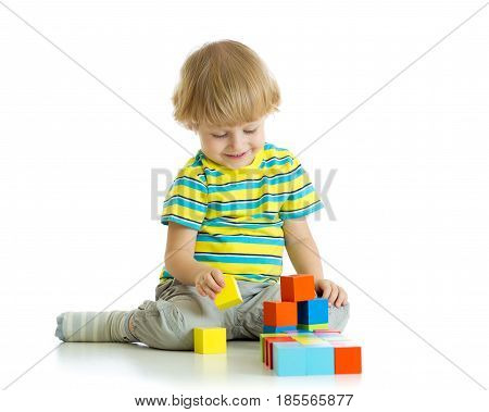 kid boy playing toy blocks isolated over white