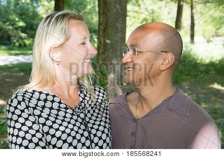Mixed Couple With A Blonde Woman And A Man Of Indian Origin