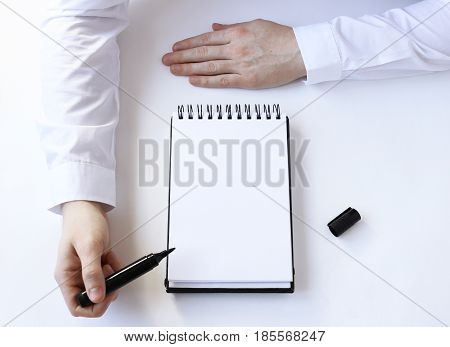 buisness process. Hand points to a notepad