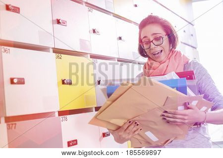 Overworked businesswoman holding documents in locker room at creative office