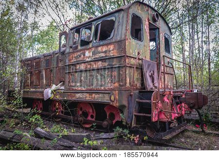 Old rusty locomotive near Prypiat ghost town of Chernobyl Exclusion Zone Ukraine