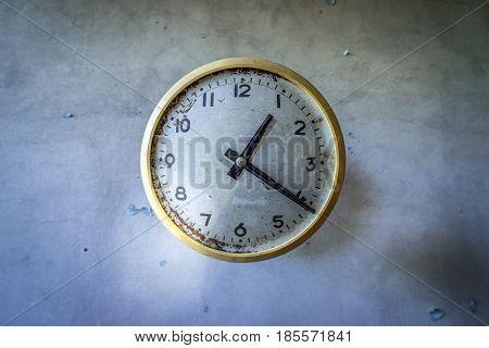 Clock in former factory in Pripyat desolate city in Chernobyl Exclusion Zone Ukraine