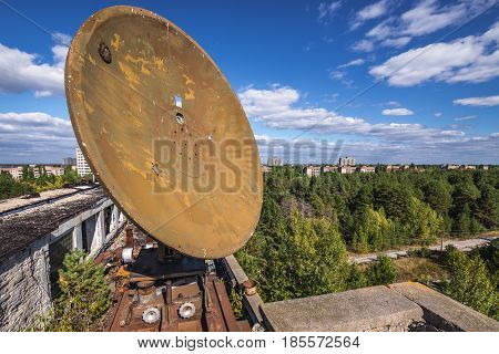 On the roof of desolate factory in Pripyat desolate city in Chernobyl Exclusion Zone Ukraine