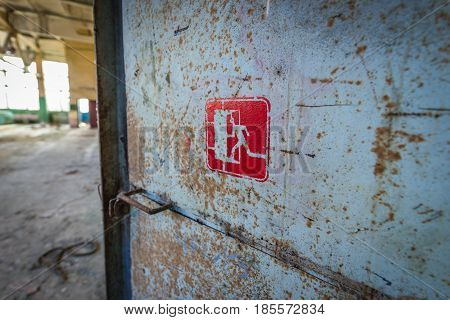 Exit sign in desolate factory in Pripyat desolate city in Chernobyl Exclusion Zone Ukraine