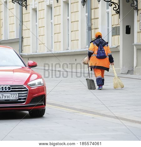 Moscow, Russia - May, 7, 2017: Municipal yard-keeper works on Moscow street
