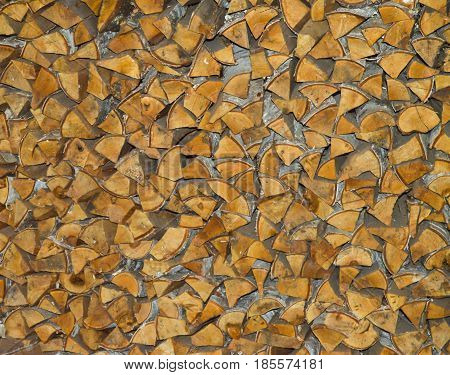 Neatly stacked logs of fire wood, background