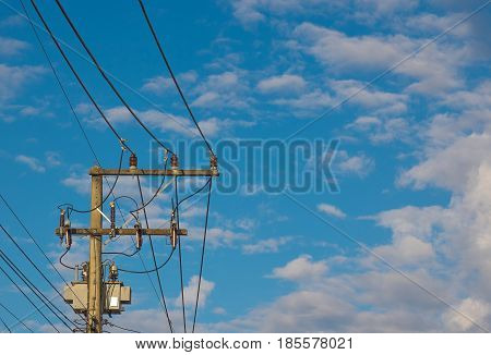 Electric pole behind the sky;The electric pole and electric transformer with clear blue sky