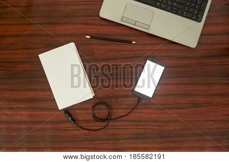 Smartphone Connected To A Book. Data Transfer.