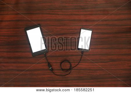 Tablet Connected To Smartphone. Data Transfer.