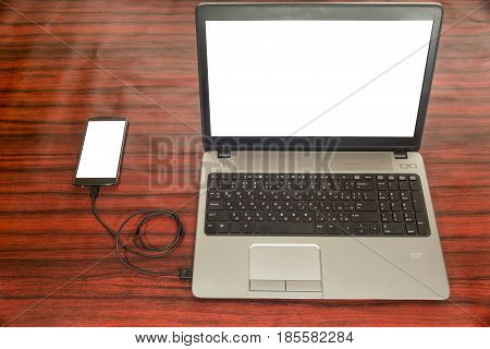 Mobile Phone Connected To Computer. Data Transfer.