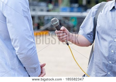 Microphone in focus. Press or media interview.