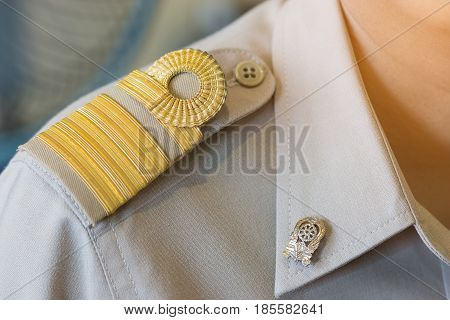 THAILAND - APRIL 15: Unidentified Thai teacher in formal officer government uniform with Brown suite and Golden stripe on shoulder thailand education on APRIL 15 2017