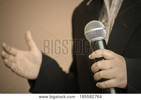 Businesswoman speech with microphone hand gesturing protesting or belief concept for explaining