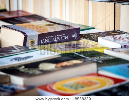 LONDON UK - 6 APRIL 2017: Full frame detail of a book sellers stall with focus on the complete works of Jane Austen.