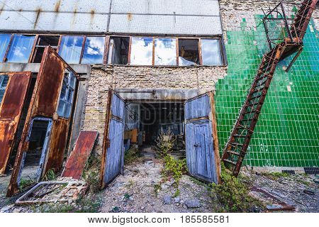 Building of desolate factory in Pripyat desolate city in Chernobyl Exclusion Zone Ukraine