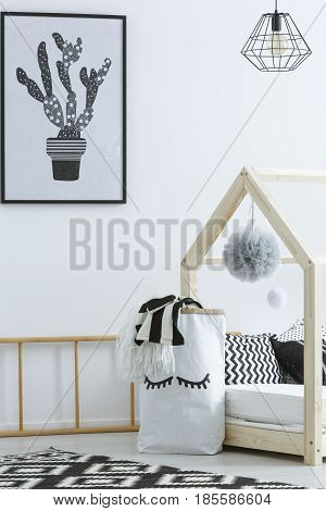 Black and white decor of cozy room designed for kid