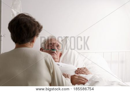 Wife Sitting By Dying Husband