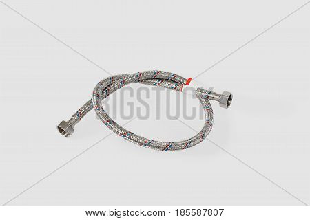 Hose braided in a braid. Isolated on a gray background.