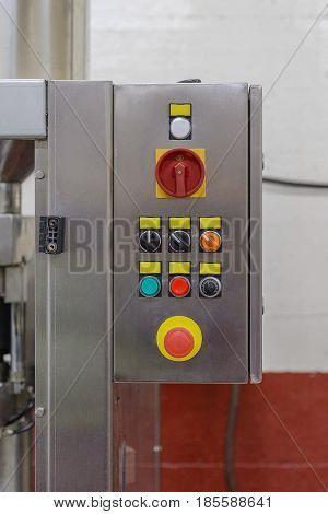 buttons on the control panel of an industrial conveyor close-up