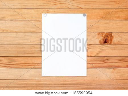 Empty Paper Ad Loose Leaves On A Wooden Wall. Attached Metal Buttons. Blank Advertisement With Cut S