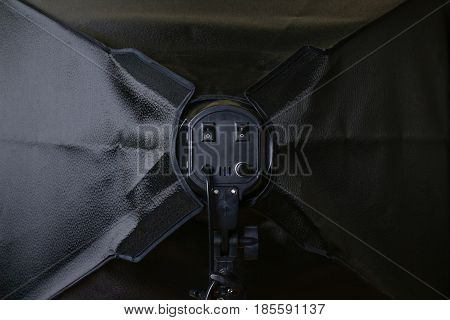 Softbox from behind. Black color. Close up