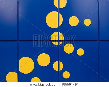 Background of Bright blue walls with large tiles and yellow spots