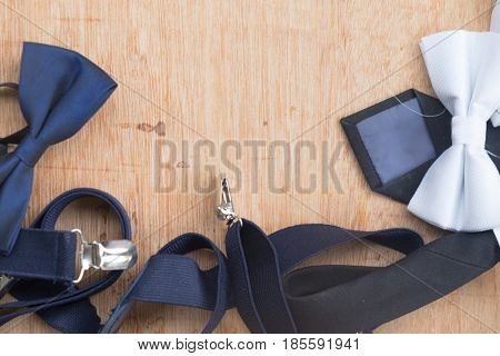 Set of man's accessories (bowtie and necktie) on wood table