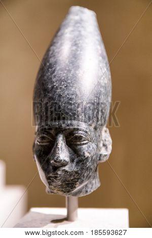 BERLIN GERMANY - APRIL 7: Head of a statue of Amenemhat III in Egyptian museum on April 7 2017 in Berlin