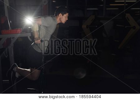 Muscular bodybuilder working out in gym doing exercises parallel bars. Concept sport. copy space