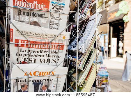 PARIS FRANCE - MAY 9 2017: INternational press newspapers front pages with the picture of the newly elected French president Emmanuel Macron after the second round French Presidential election