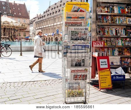 STRASBOURG FRANCE - MAY 9 2017: Newspaper stand with front page with the picture of the newly elected French president Emmanuel Macron after the second round French Presidential election