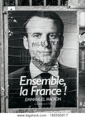 PARIS FRANCE - MAY 9 2017: Black and whote of Emmanuel Macron portrait poster detail next to polling place after the second round French presidential election marker inscription Member of Bilderberg group