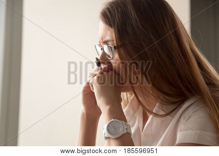 Portrait of worried businesswoman focused on work. Pensive female thinking about problem solution. Stressed woman with head resting on hands concentrated on pondering solution. Psychological burnout
