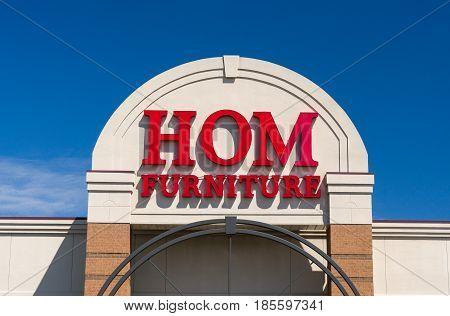 Hom Furniture Exterior And Logo
