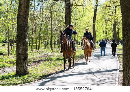 Samara Russia - May 7 2017: Female mounted police on horse back in the city park