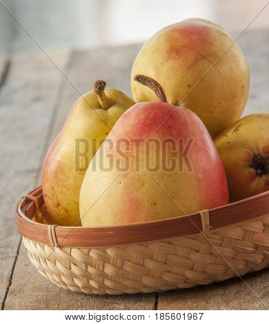 Fruit background. Fresh organic pears on wood. Pear autumn harvest