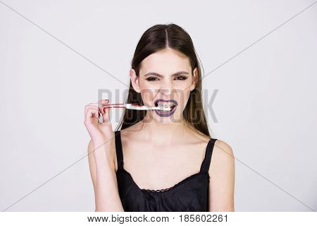 Girl With Teeth Braces And Brush, Has Fashionable Makeup